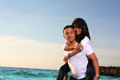Couple honeymoon at beach Stock Photography
