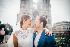 Couple on honeymoon near Eiffel Tower in Paris Royalty Free Stock Image