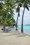 Couple on Honeymoon relax on Aitutaki lagoon Stock Photo