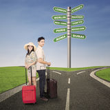 Couple honeymoon travel with luggages. And road sign Royalty Free Stock Photos