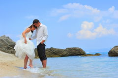 Couple of honeymooners by the sea shore Stock Images