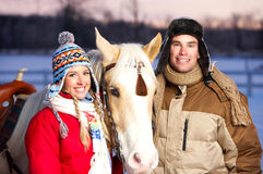 Couple with horse Stock Images