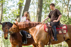 A couple on a horse ride Royalty Free Stock Photos