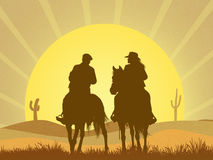 Couple on horseback in the desert Royalty Free Stock Photos
