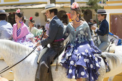 Couple on horseback at the fair Royalty Free Stock Photo