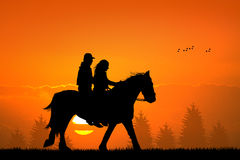 Couple on horseback Stock Images