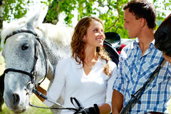 Couple with horses Royalty Free Stock Image