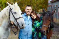 Couple with horses Stock Photography