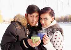 Couple with a hot drink Royalty Free Stock Photos