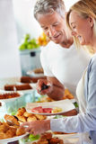 Couple at hotel buffet Royalty Free Stock Images