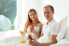 Couple at hotel room Royalty Free Stock Images