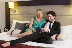 Couple in hotel room Stock Images
