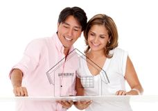Couple with a house Stock Images