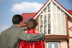 Couple and house Stock Photos