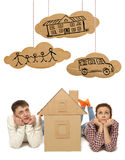 Couple with house of cardboard Stock Images