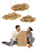 Couple with house of cardboard Stock Photography