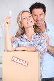 Couple with house key Stock Images