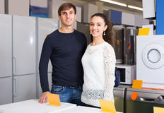 Couple at household appliances section Royalty Free Stock Photos