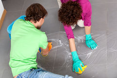 Couple during housework Royalty Free Stock Image