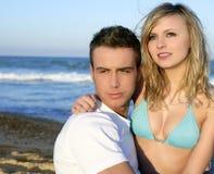 Couple hug on the blue beach Stock Image