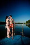 Couple in hug and kiss on boat Stock Images