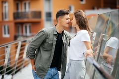Couple hug and kissing dating on bridge. Couple kissing dating on bridge during sunset Stock Photos