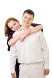 Couple hug one another Stock Image