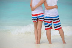 Couple hug together on the beach Stock Images