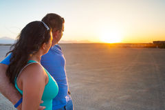 Couple in hug watching together sunset. On the desert Royalty Free Stock Images