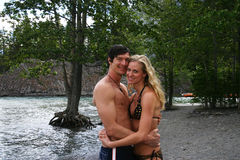 Couple hugging. Beside a river Stock Image