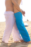 Couple hugging. Young loving couple hugging on sandy beach Royalty Free Stock Photos