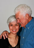 Couple hugging. Attractive mature couple holding each other tight royalty free stock images