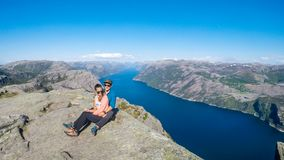 A couple hugging and in the background is a fjord. Norway, Preikestolen. royalty free stock photo