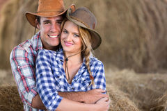 Couple hugging barn. Portrait of young cute farming couple hugging in barn royalty free stock photo