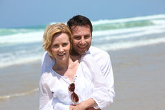 Couple hugging on the beach. During their honeymoon Royalty Free Stock Photography