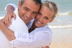Couple hugging on the beach Stock Photography