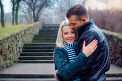 Couple hugging. Beautiful couple hugging in the park royalty free stock images