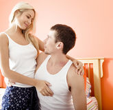 Couple Hugging in Bedroom Royalty Free Stock Photography