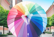 Couple hugging behind the umbrella Stock Photography