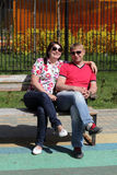 Couple hugging on a bench Stock Photography