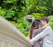 Couple hugging in Central Park. Couple hugging and having a private moment on Bow Bridge in Central park in New York City royalty free stock photo