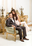 Couple hugging on chair at luxurious classic interior Stock Photos