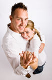 Couple hugging and displaying engagement ring Royalty Free Stock Image