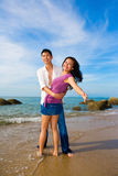 Couple hugging each other on the beach. Loving couple hugging each other on the beach during summer time with bright blue sky Royalty Free Stock Photo