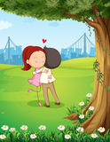 A couple hugging each other near the tree Royalty Free Stock Image