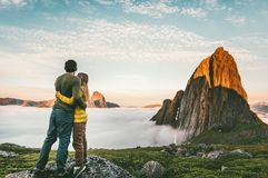 Couple hugging enjoying mountains landscape family traveling together. Healthy lifestyle concept summer vacations outdoor hiking in Norway stock image