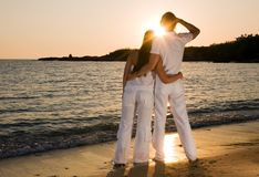 Couple hugging, enjoying summer sunset. Royalty Free Stock Photography