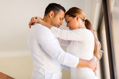 Couple hugging eyes closed Stock Photos