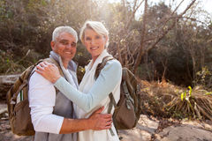 Couple hugging forest. Portrait of happy middle aged couple hugging in forest royalty free stock images