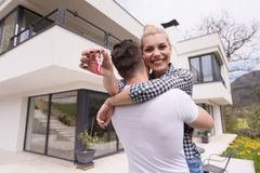 Couple hugging in front of  new luxury home Royalty Free Stock Photo